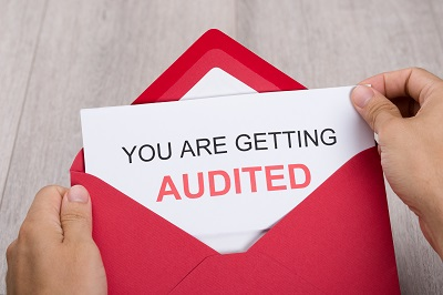 red envelope with auditing notice